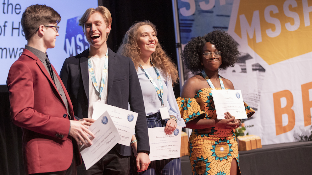 Students on stage at Maine State Science Fair