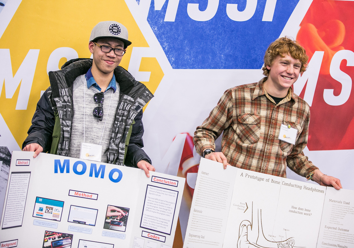 High school students showing their posters at Maine State Science Fair