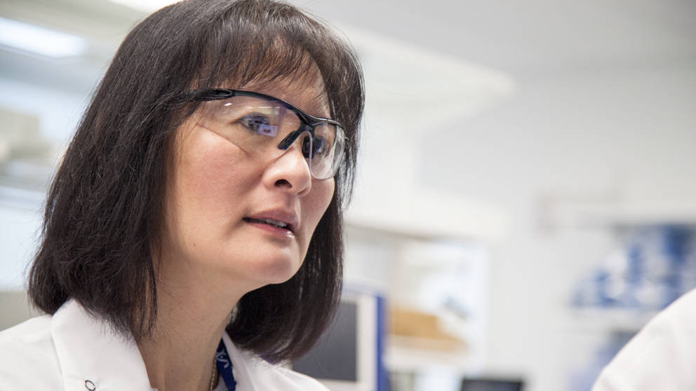Chia Lin Wei, Director, Genome Technologies in lab